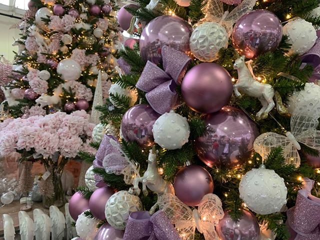 Fairytale Christmas decorations with pink and white baubles and unicorns on a tree