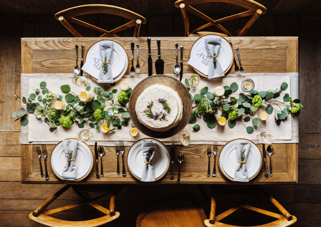 wedding table with foliage and candles