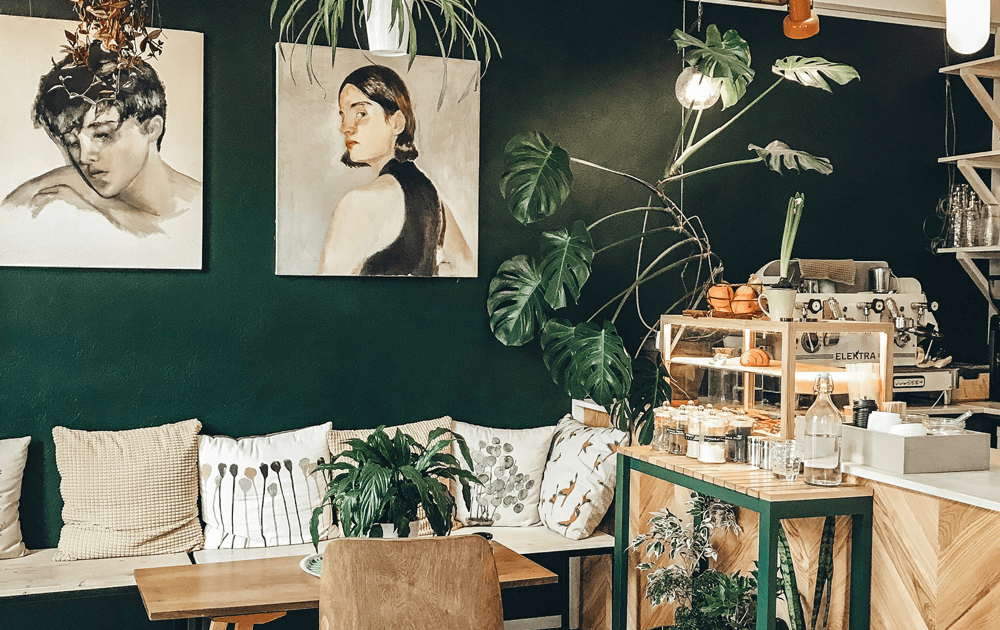 cafe interior with green walls and nature theme