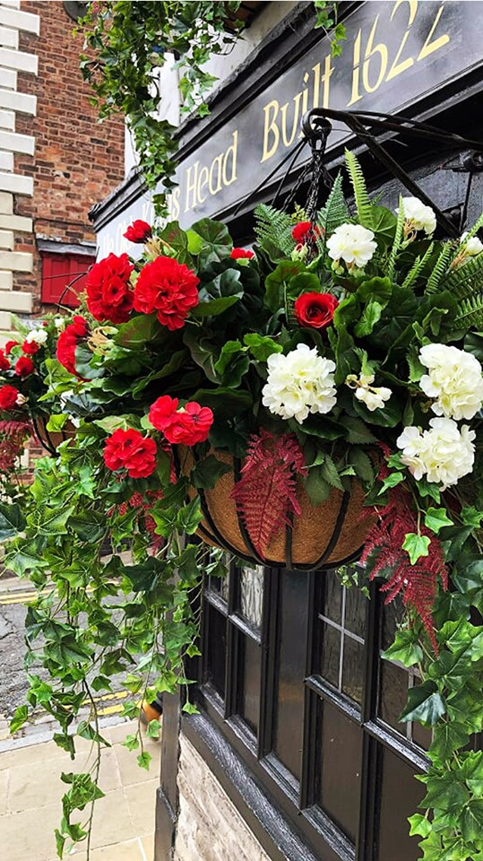 close up of artificial hanging baskets at Ye Olde Kings Head pub commercial project