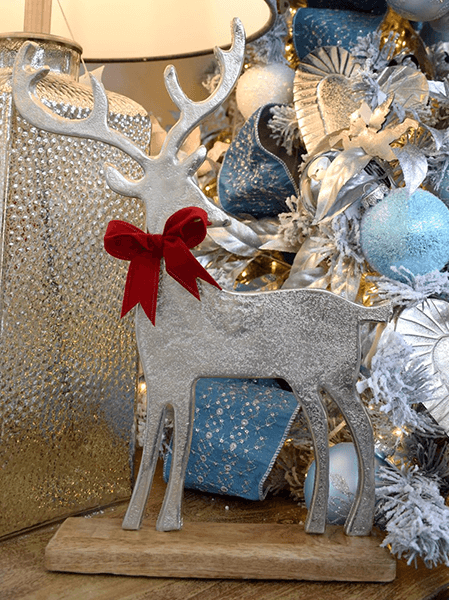 silver, red and light blue christmas theme with silver reindeer and red bow