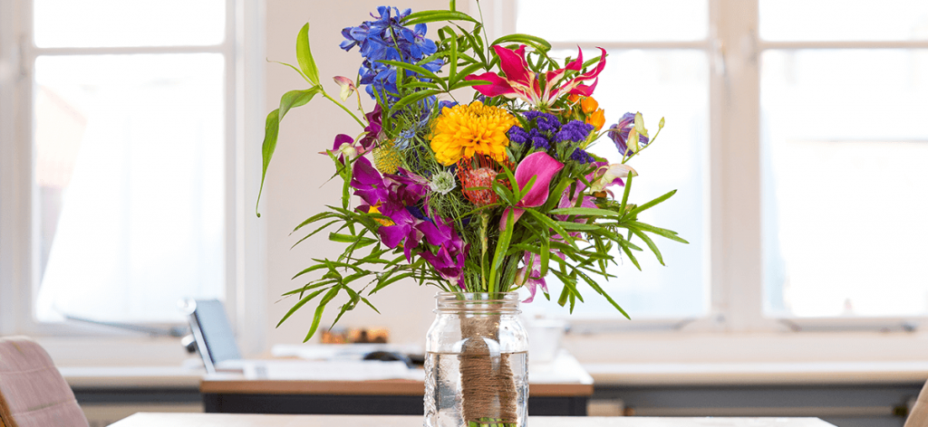 70's psychedelic floral trend for 2020 in glass jar