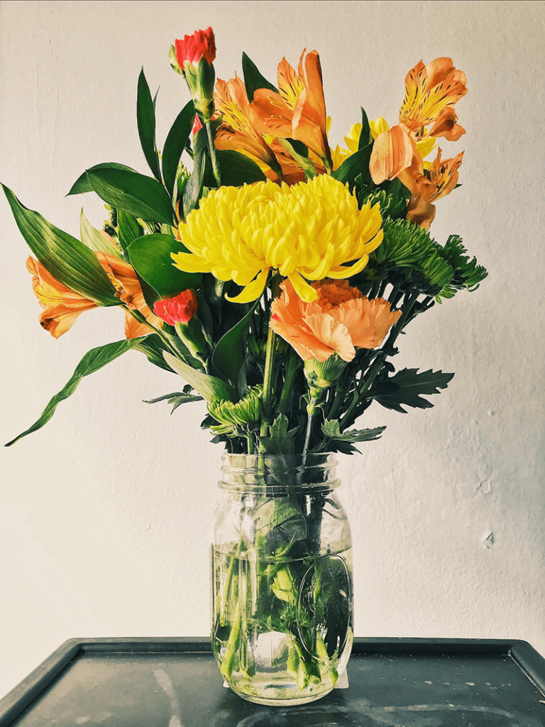 yellow and orange 70's inspired floral arrangement