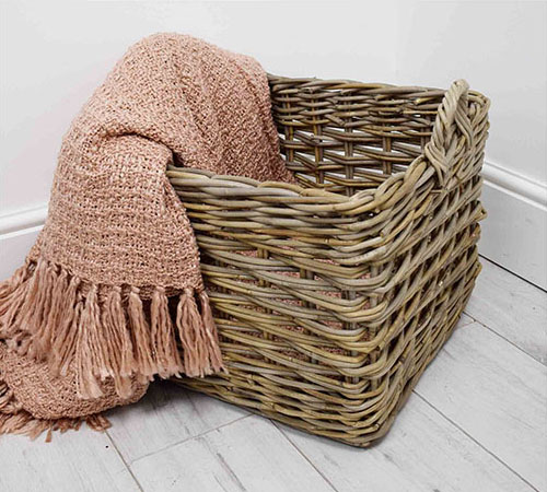 square basket with pink blanket
