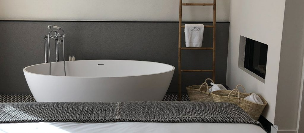bath with towels in baskets in the bedroom
