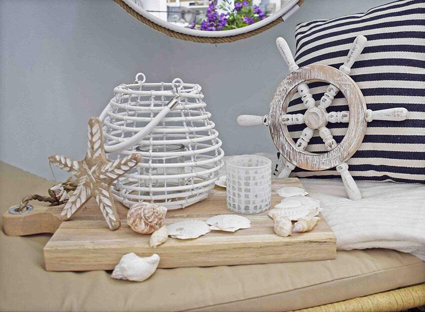 nautical theme decor ideas white lantern, shells, ships wheel arrangement