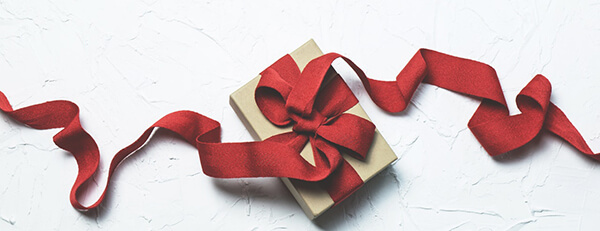 red ribbon on a present - gift decorating ideas