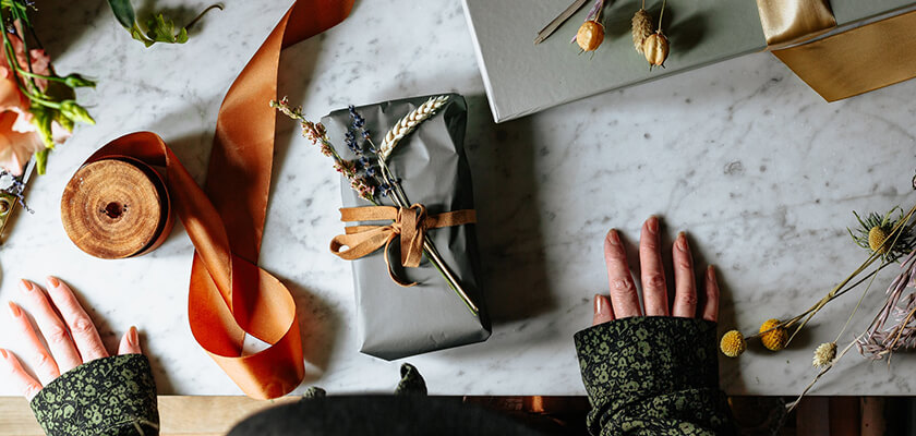 contemporary gift wrapping ideas - artificial flowers and foliage toppers