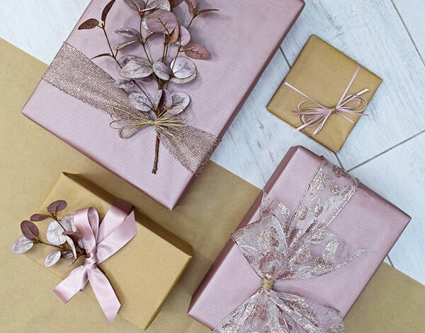 gift wrapping dusty pink bows ribbons eucalyptus topper