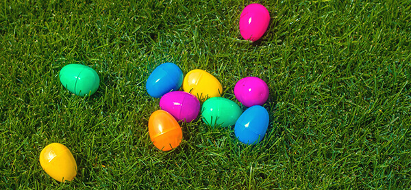 plastic east egg hunt supplies on grass lawn