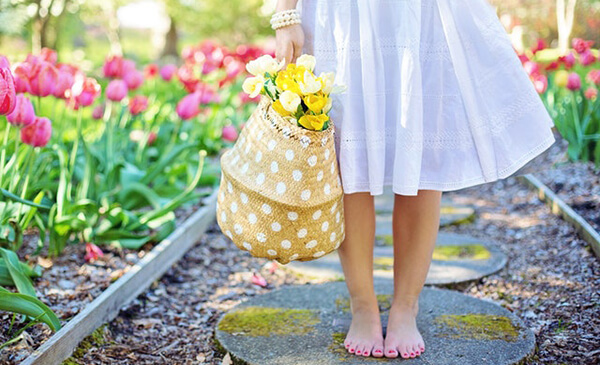 easter egg hunt supplies - lady with daffodils in garden