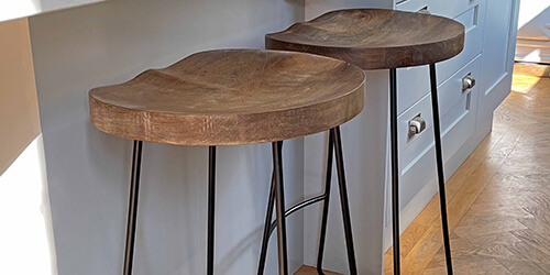 contemporary indoor furniture - grey velvet style armchair on parquet floor