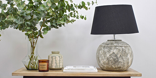 contemporary homeware supplies - wooden bull statue and photo frames on table